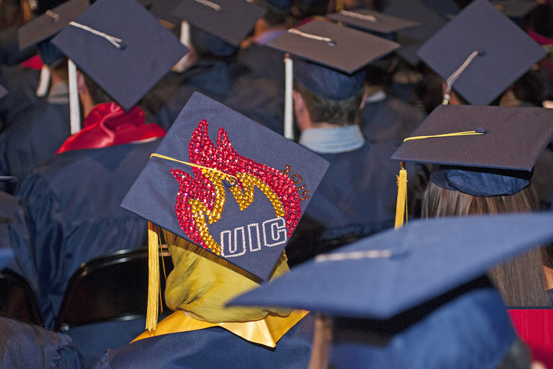 Commencement ceremony, student wears bedazzled cap.