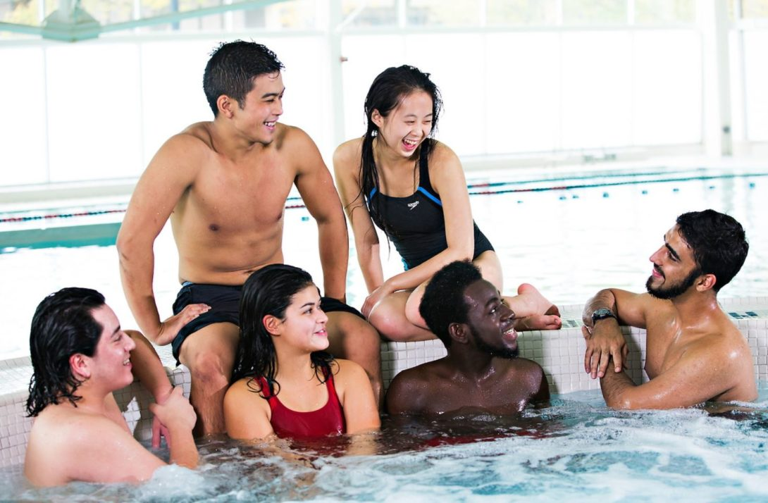 Students socializing in the pool