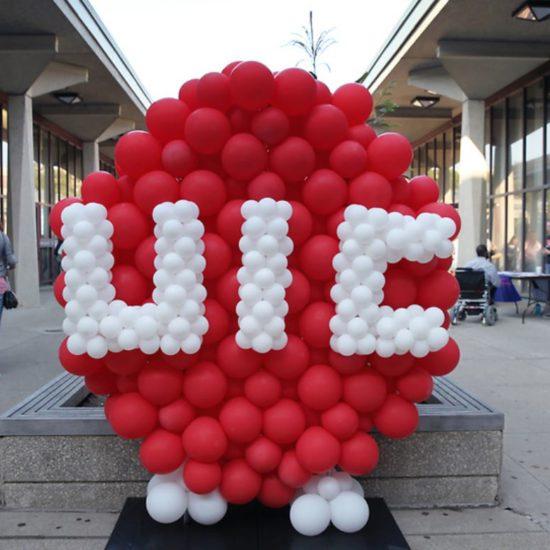 UIC logo with ballons